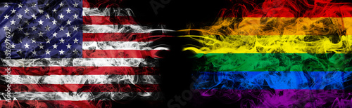 Obraz American flag and rainbow flag in smoke shape on black background. Concept of conflict and LGBT rights. America VS LGBT community metaphor. Tension and crisis for civil right and gay pride. - fototapety do salonu