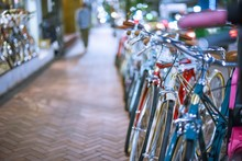 Close-up Of Cropped Parked Bicycles