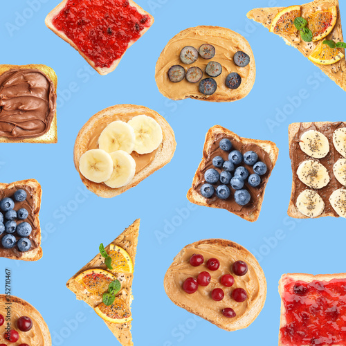 Fototapeta Set of delicious toasted bread with different toppings on blue background, top view obraz
