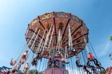 Low Angle View Of People On Amusement Park Ride