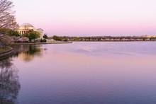 Thomas Jefferson Memorial By Lake At Sunset