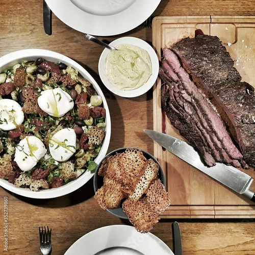 Leinwand Poster Directly Above Shot Of Flap Steak Served With Brussels Sprouts Salad With Poache