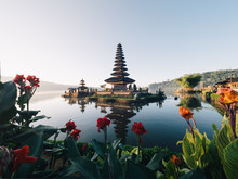 Temple Amidst Lake Against Clear Sky