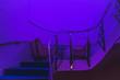 Leinwanddruck Bild - Empty Chairs On Staircase In Illuminated Room