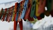 Low Angle View Of Colorful Clothespin Hanging On Clothesline