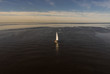 Sailing yacht in the open sea number 13. View from the top point.
