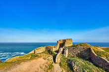 Image Of Grosnez Castle Keep Constructed Circa 1330 And Located In The North West Corner Of Jersey Early Morning With The Sea In The Background And Blue Skys.  Jersey, Channel Islands, UK