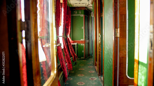 Obraz na plátně Interior of vintage express train with carpet and wooden doors