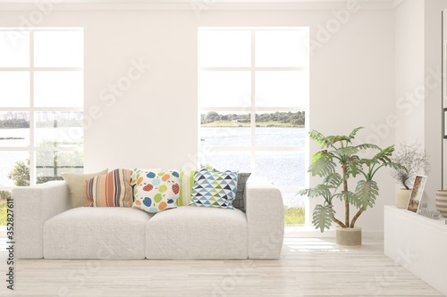 Obraz White living room with sofa and summer landscape in window. Scandinavian interior design. 3D illustration - fototapety do salonu