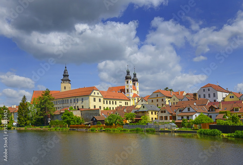 Fototapety, obrazy: Panorama of Telc. Telc is a town in southern Moravia in the Czech Republic. City reflected in lake. The historic center of Telc is a UNESCO World Heritage Site