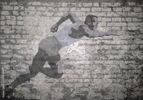 Grunge decayed faded brick wall background with stylized athletic sprinter Canvas Print