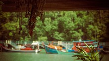 Boats Parked By The River As N...