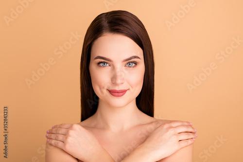 Obraz Close up photo of charming positive girl hug herself feel body harmony enjoy wellnes after salon skincare treatment isolated over beige color background - fototapety do salonu