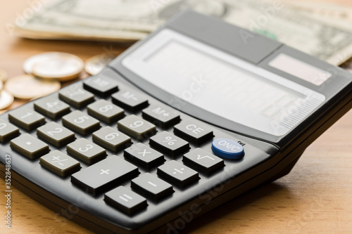 Fototapety, obrazy: Coin money and banknote bills with a calculator. ballance reduction