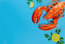 Cooked Wild Caught Lobster With Lemon On Blue Background.