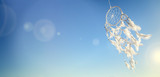 Dream catcher on blue sky background with copy space