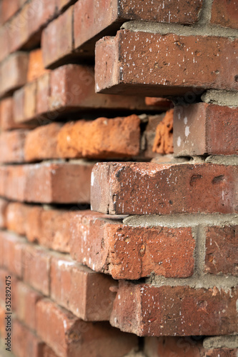 Broken corner on a brick wall