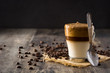Creamy iced dalgona coffee on wooden table. Copy space