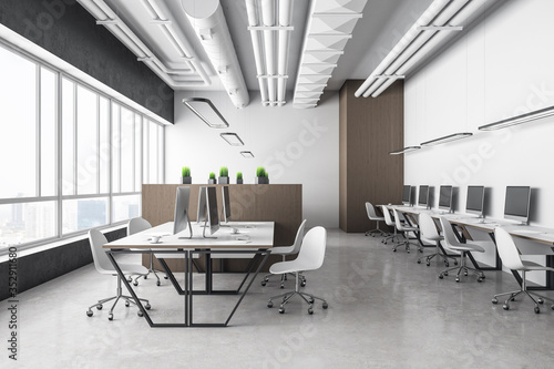 Contemporary blurry coworking office interior with equipment