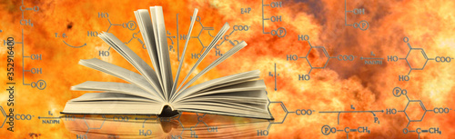 open book on the background of chemical formulas and flames #352916400