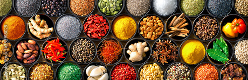 Fotografie, Obraz Colourful background from various herbs and spices for cooking in bowls