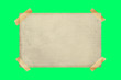 canvas print picture - old paper stopped with adhesive tape on a green screen background. Copy space, ideal for inserting text. sheet of old lino