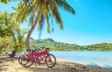 Cycling Tourism E-bike Bikes Biking Tour Excursion Tourists Summer Vacation Travel Landscape. Tahiti Island Bicycles On Beach.