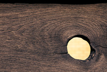 A Big Hole In The Fence. Wooden Texture With A Hole From A Loose Knot. For Design On The Subject Of Peeping For Secrets, Neighbors.