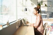 Woman Using Laptop In Coworkin...