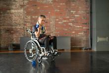 Senior Man In Wheelchair Doing...