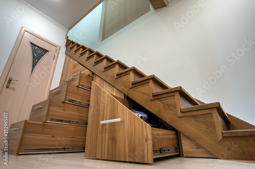 Fotografie, Obraz Modern architecture interior with luxury hallway with glossy wooden stairs in multi-storey house