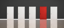 Red Door Among White Ones In Room. Concept Of Choice
