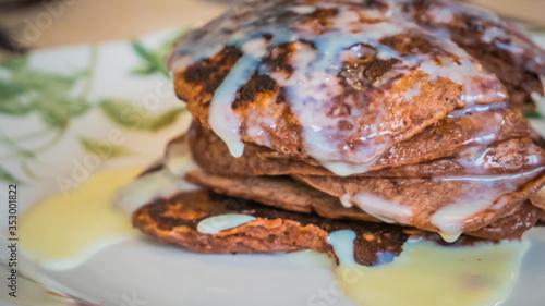 Fototapeta A delicious tower of tasty pancakes with condense milk obraz na płótnie