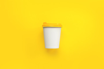 Takeaway coffee cup on color background