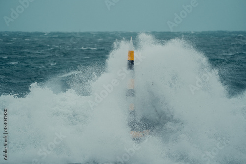 Fotografie, Tablou A once in a decade storm hitting the iconic Cottesloe bollard
