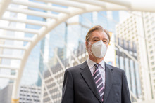 Mature Businessman With Mask F...