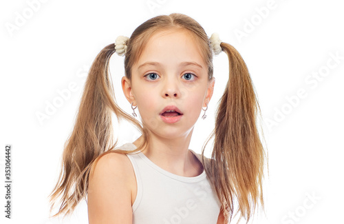 Young cute bemused puzzled girl with grey blue eyes and two hair tails isolated Wallpaper Mural