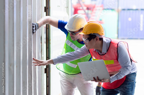 Engineer inspection and checking goods cargo container wall strength for safety according to international rule and Intermodal containers standard Slika na platnu