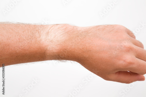 Young man showing not tanned arm skin from watch Fotobehang