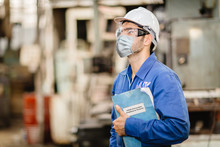 Worker Wearing Face Shield Or Disposable Face Mask With Coronavirus(Covid-19) Prevention Guidlines Manual Hand Book For Guidance Rule To Healthy Work In Factory.