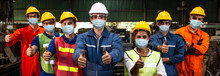 Group Of Worker Wearing Face S...
