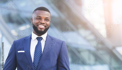 Fototapeta Joyful Businessman Smiling Standing In Urban Area In City obraz