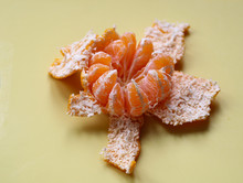 Peeled Tangerine On A Light Background Close Up