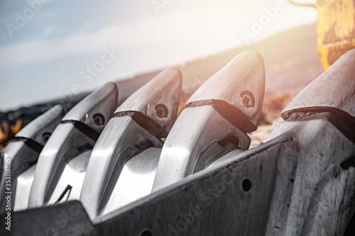 Fotografie, Obraz excavator steel bucket working on construction open mining site
