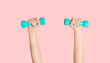 Young Girl Lifting Dumbbells O...