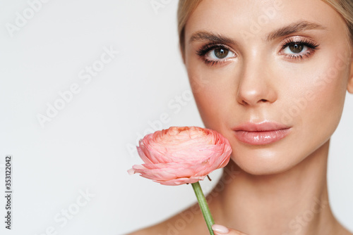 Photo Image of beautiful alluring shirtless woman posing with flower