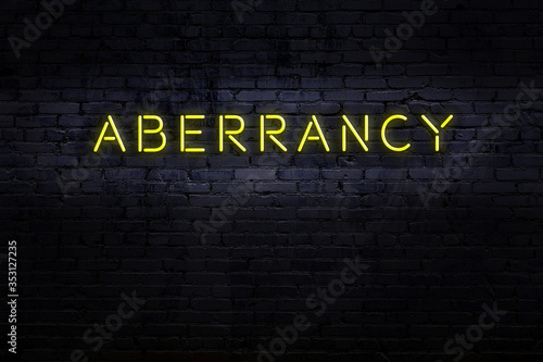 Neon sign. Word aberrancy against brick wall. Night view Wallpaper Mural