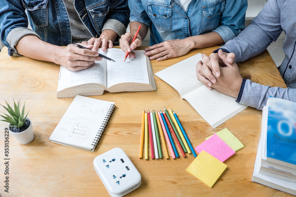 Fototapeta High school tutor or college student group sitting at desk in library studying and reading, doing homework and lesson practice preparing exam to entrance, education, teaching, learning concept