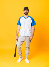 Full-length Shot Of A Man Playing Baseball Over Isolated Yellow Background