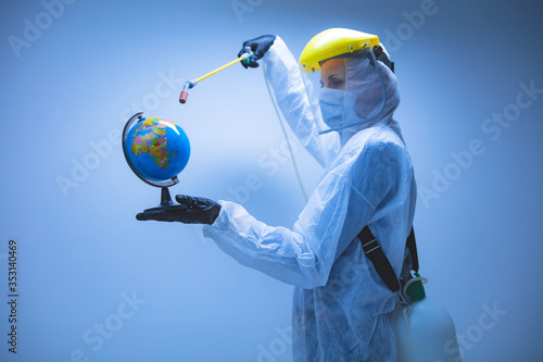 Obraz Scientist spraying Earth globe to decontaminate planet from viruses and germs. - fototapety do salonu